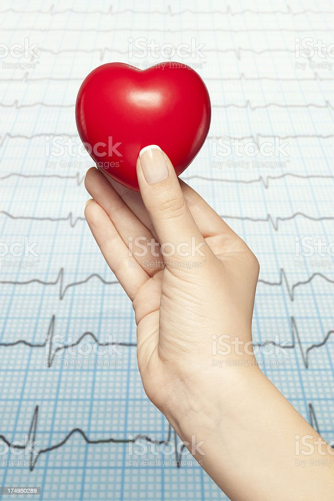 Woman hand holding red heart royalty-free stock photo