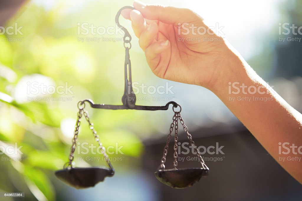 Woman hand holding scales stock photo