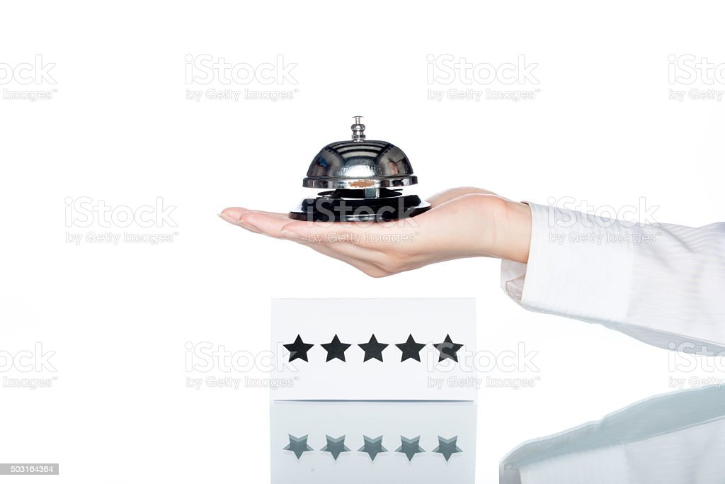 woman hand holding Service bell with five stars shape card stock photo