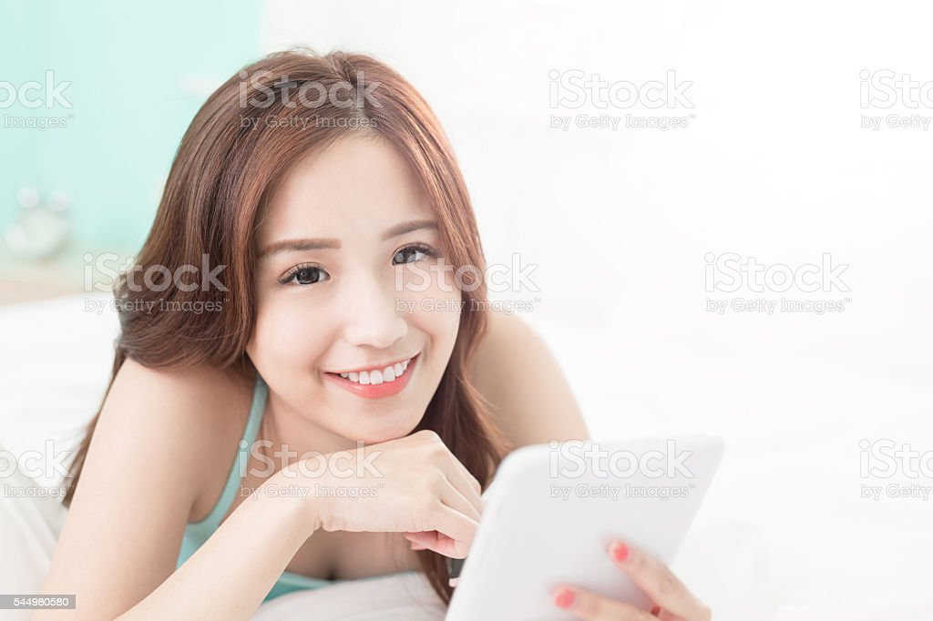 woman hand holding tablet stock photo