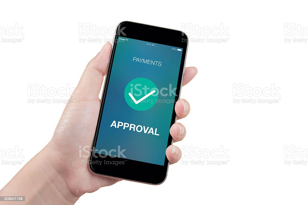 Woman hand holding the phone with approved payment screen, isolated stock photo