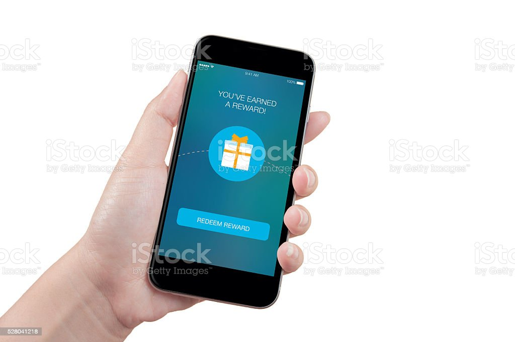 Woman hand holding the phone with reward screen, isolated stock photo