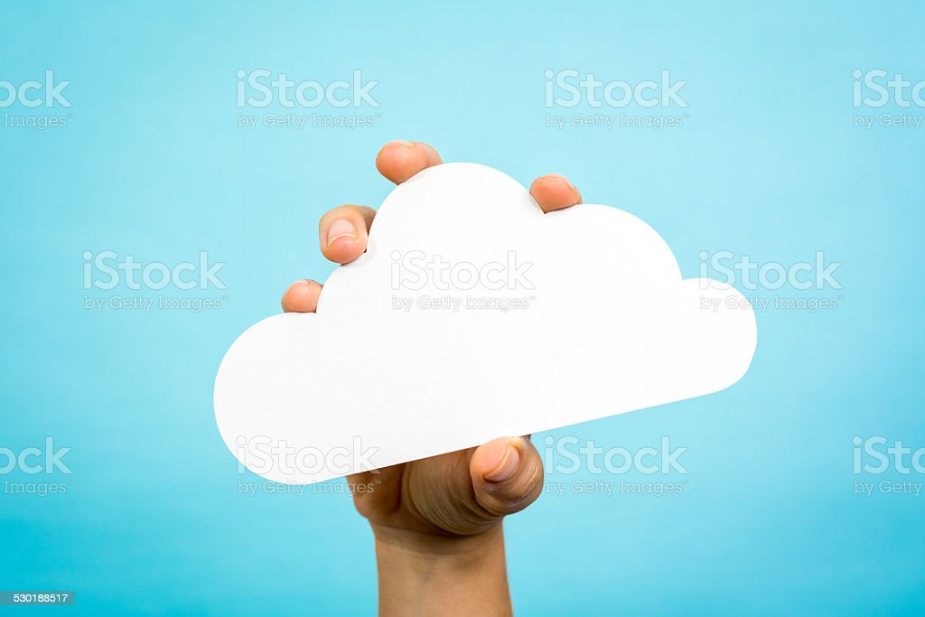 Woman hand holding white cloud computing concept vibrant blue background stock photo