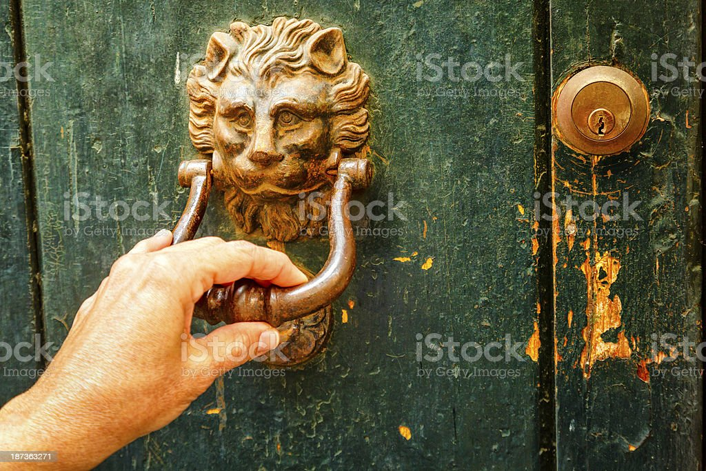 Woman hand knocking vintage door stock photo