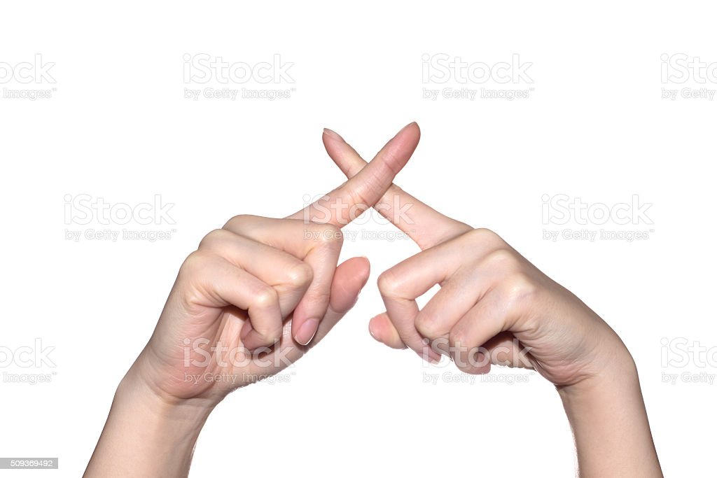 Woman hand making sign crossing fingers stock photo