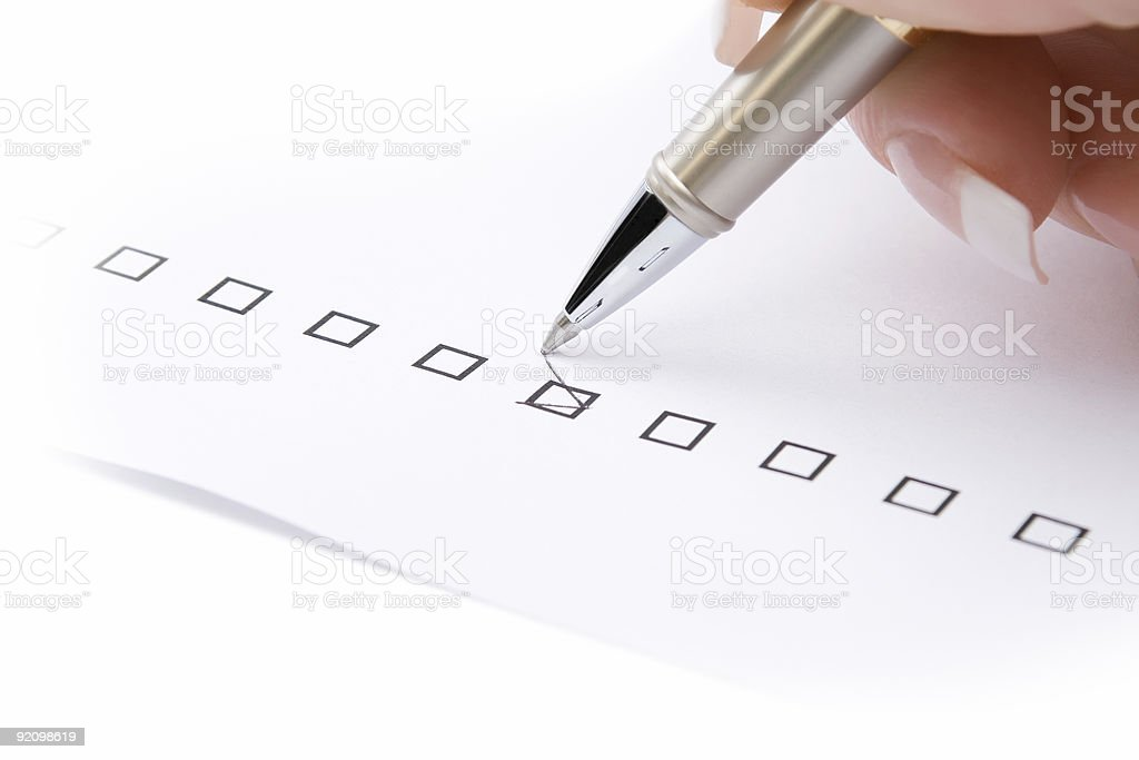 Woman hand marking a check box royalty-free stock photo
