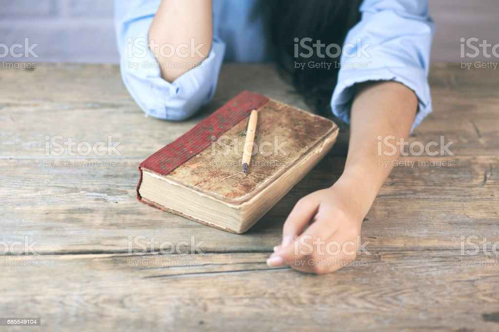 woman hand on book stock photo