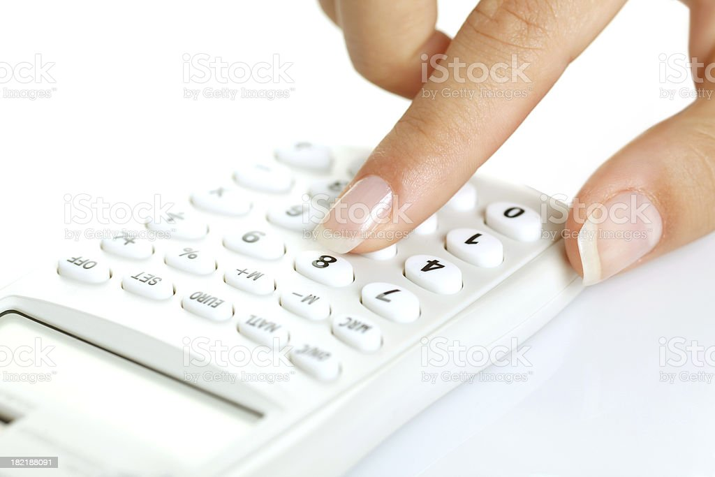 WOman hand on calculator royalty-free stock photo