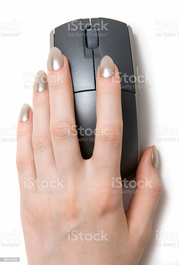 Woman hand on computer mouse stock photo
