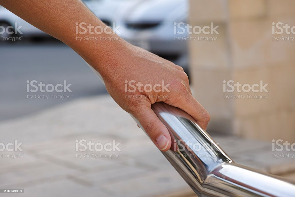 Woman hand on handrail stock photo