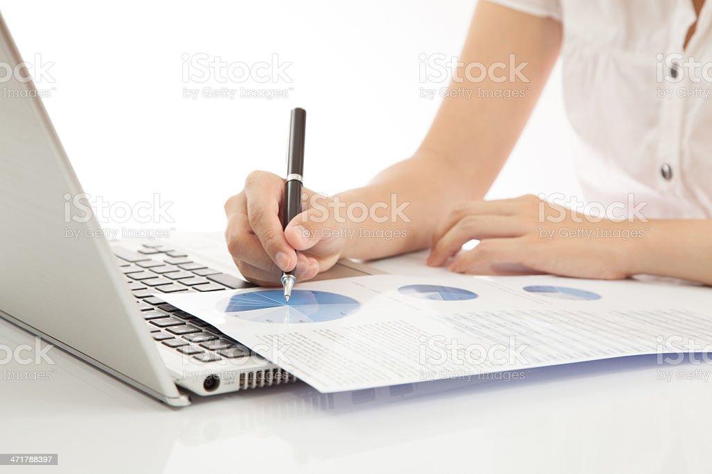 woman hand on laptop stock photo