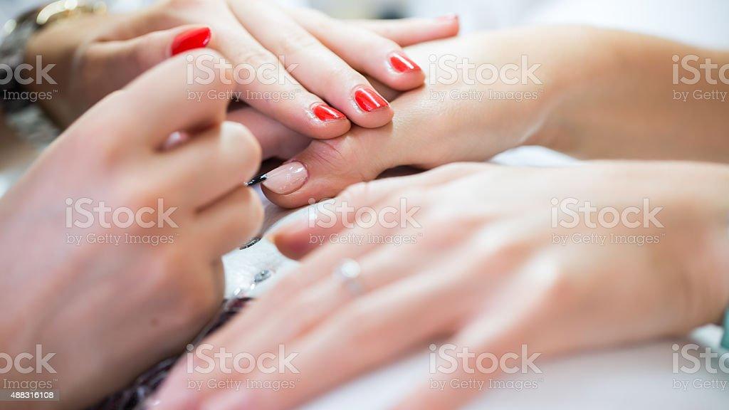 Woman hand on manicure treatment in beauty salon. Beauty parlour stock photo