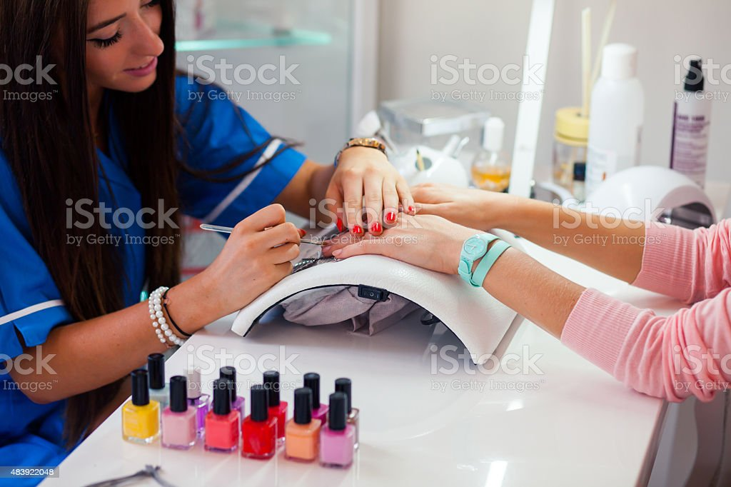 Woman hand on manicure treatment in beauty salon. stock photo