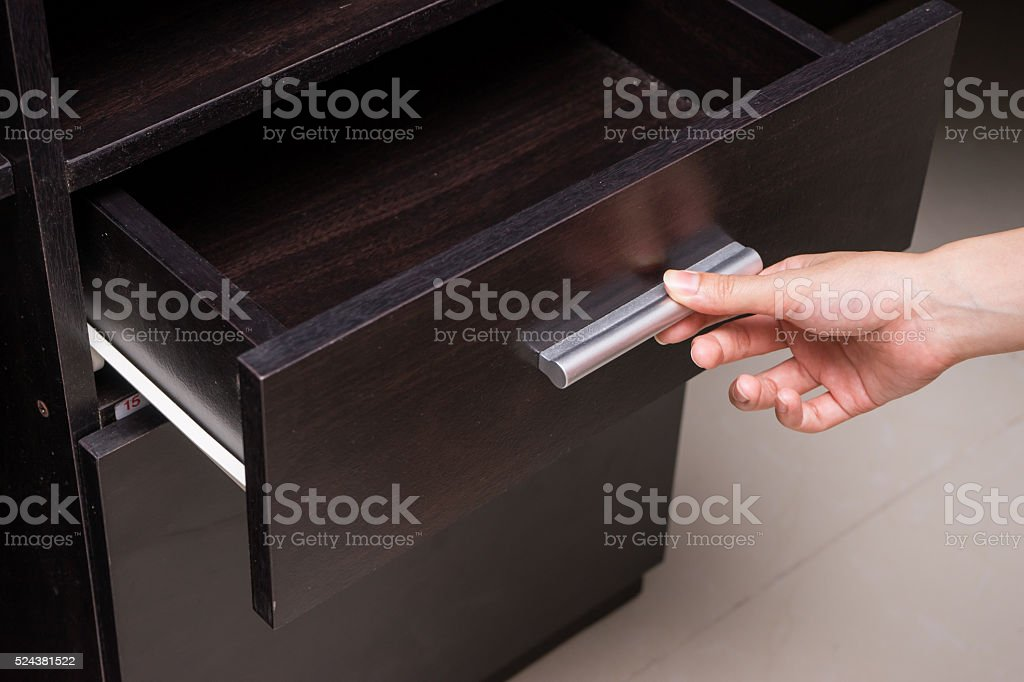 Woman hand open drawer stock photo