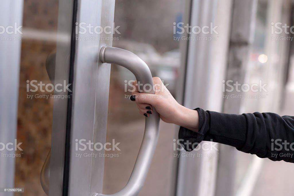 Woman hand opening door stock photo