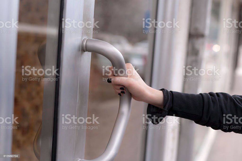 Woman hand opening door stock photo