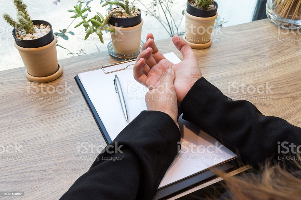 Woman hand pain on desk - office syndrome stock photo