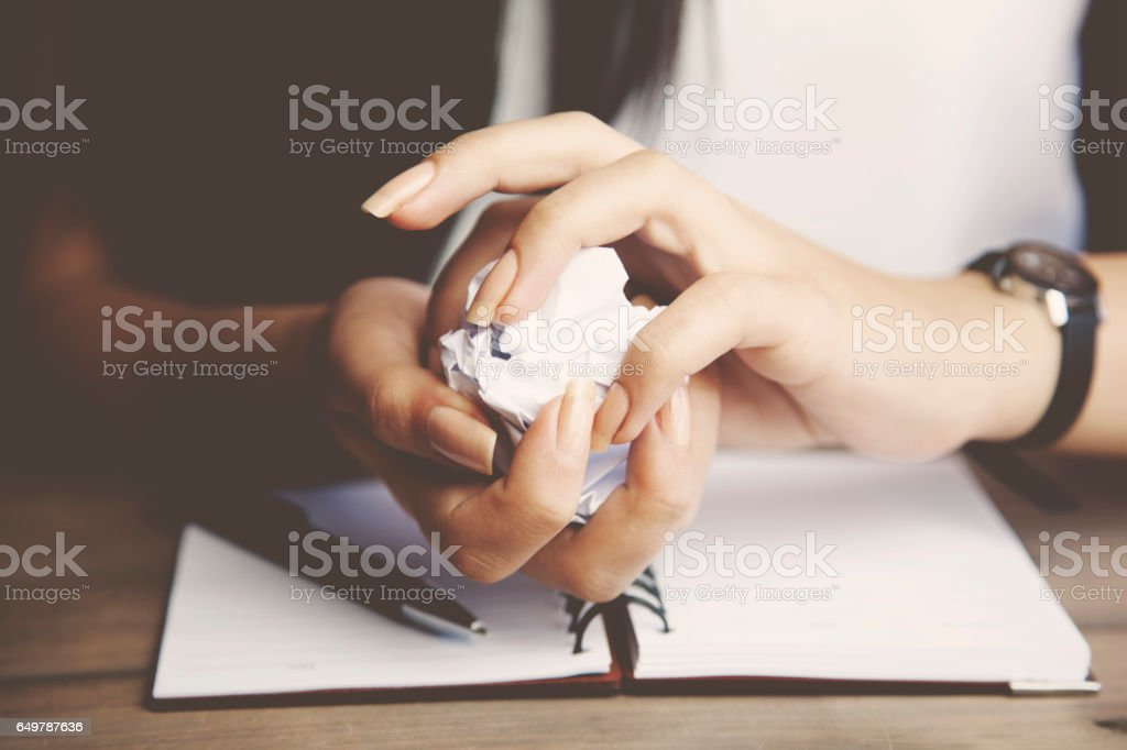 woman hand paper on wooden table stock photo
