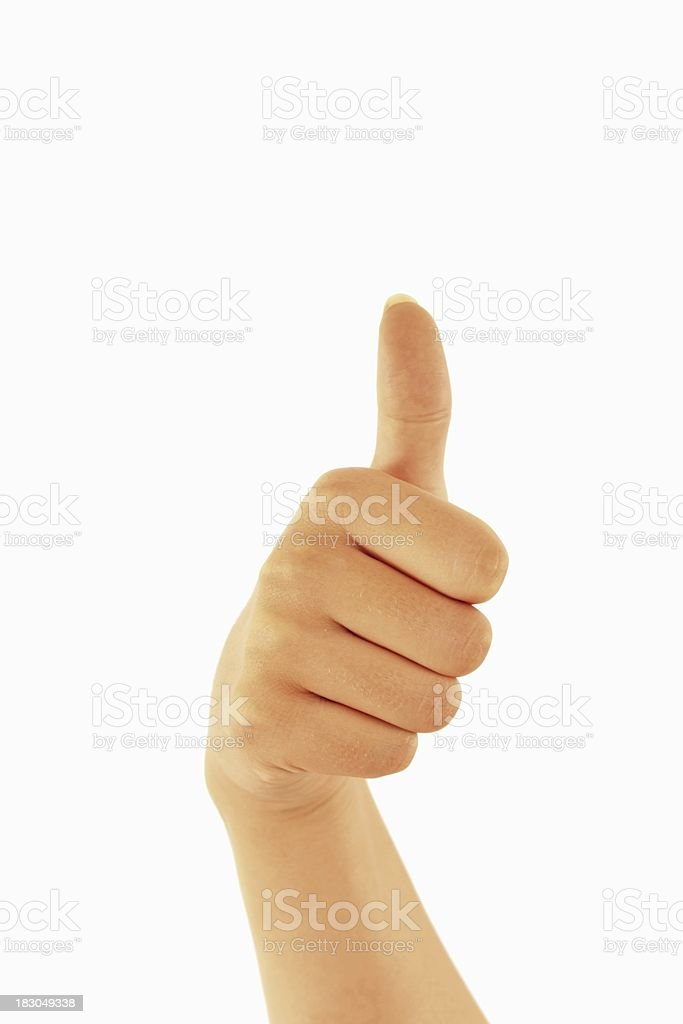Woman hand showing Thumbs up on white royalty-free stock photo