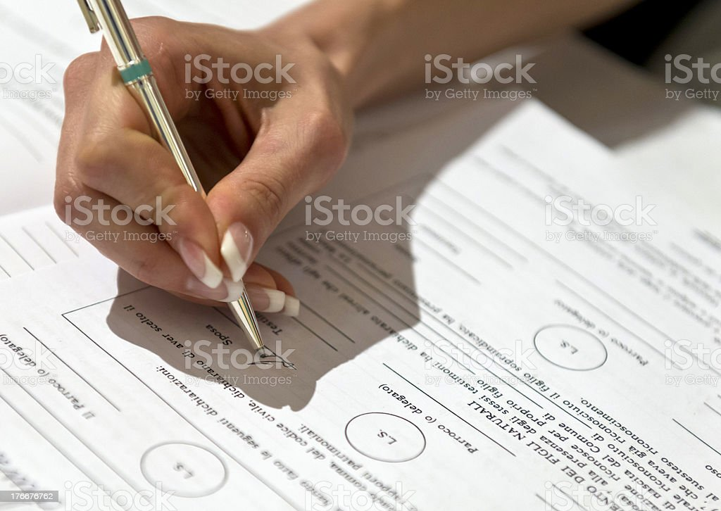 Woman hand signing contract royalty-free stock photo