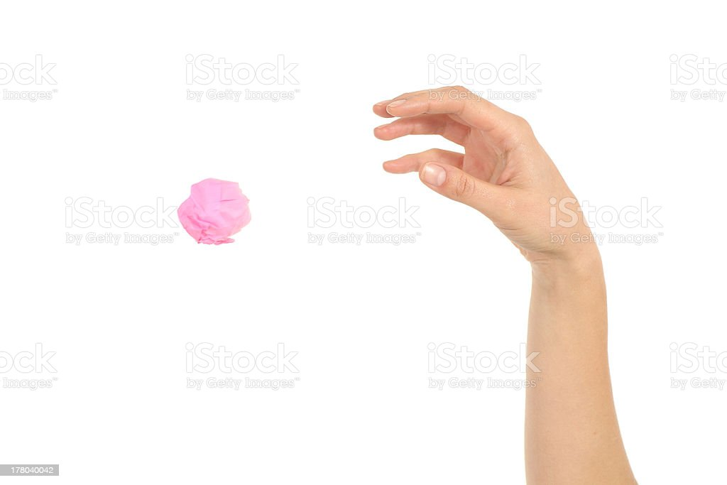 Woman hand throwing a paper stock photo