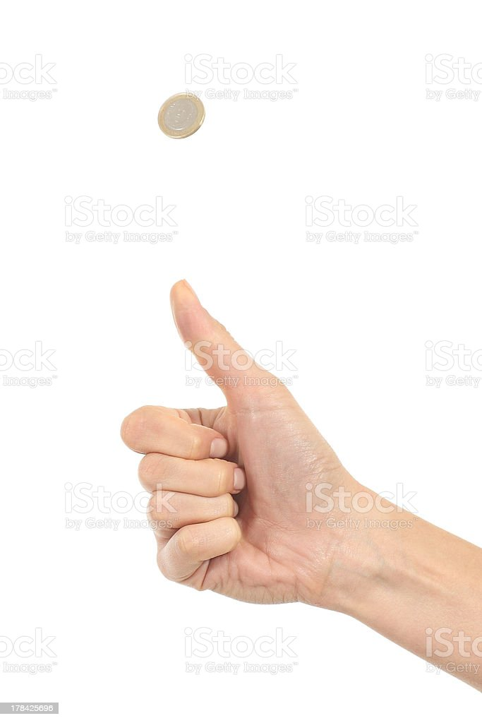 Woman hand tossing a coin stock photo