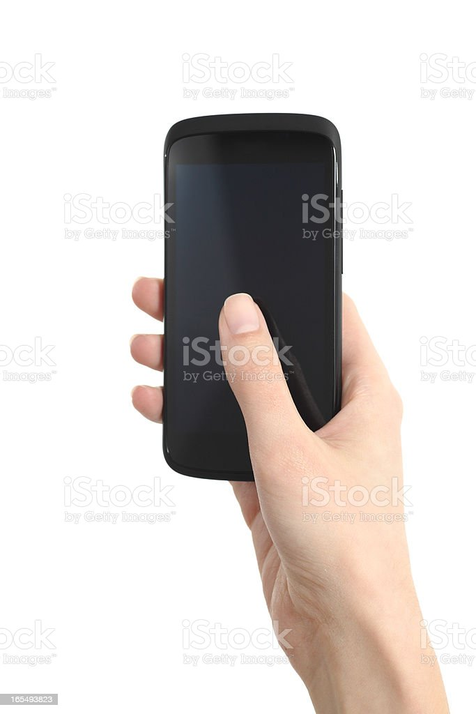 Woman hand touching a mobile phone screen with her thumb royalty-free stock photo