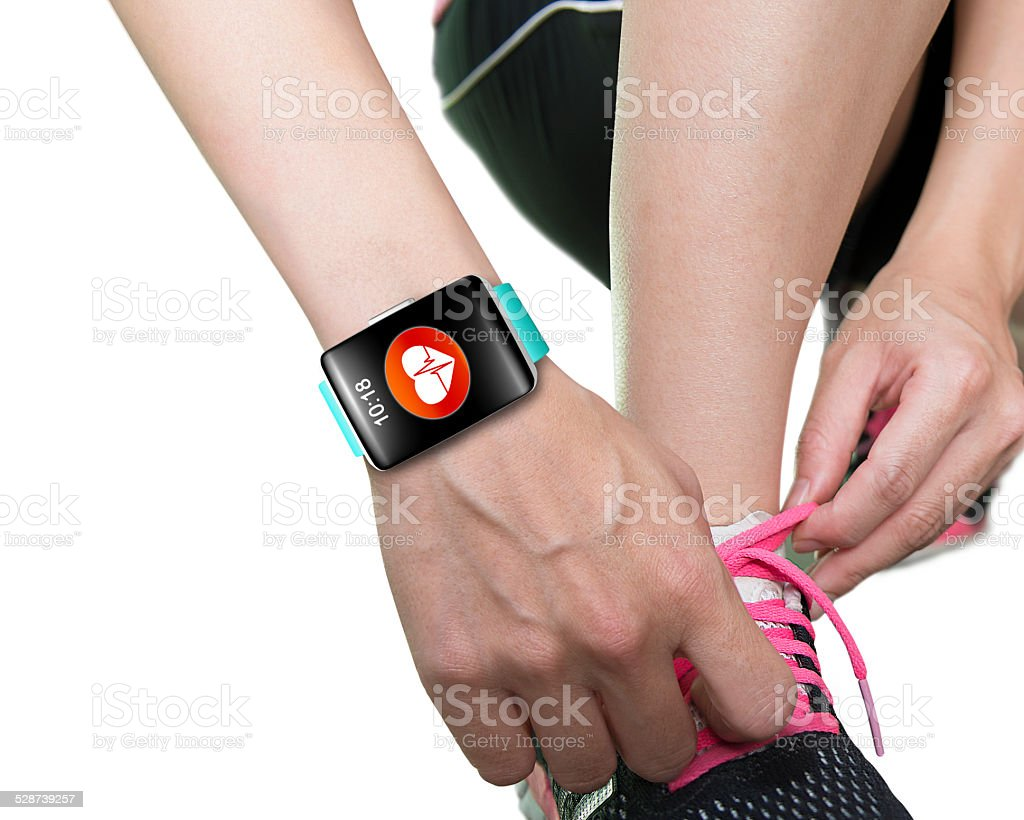 woman hand tying shoelaces wearing bright blue watchband touchsc stock photo