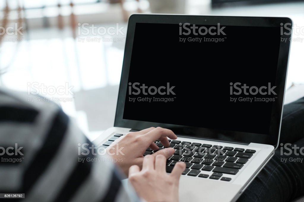 Woman hand typing labtop computer with blank screen for mock up,...