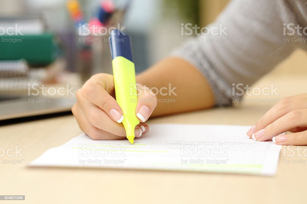 Woman hand underlining a document stock photo