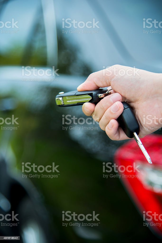 Woman hand unlocking a car stock photo