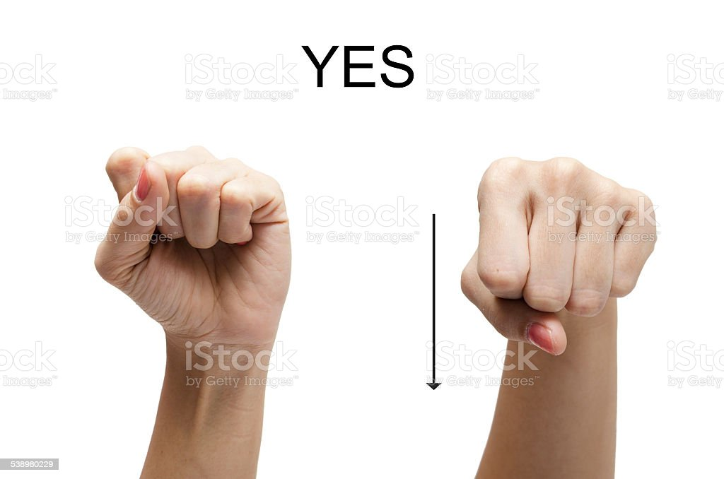 Woman hand up sign YES american sign language ASL stock photo