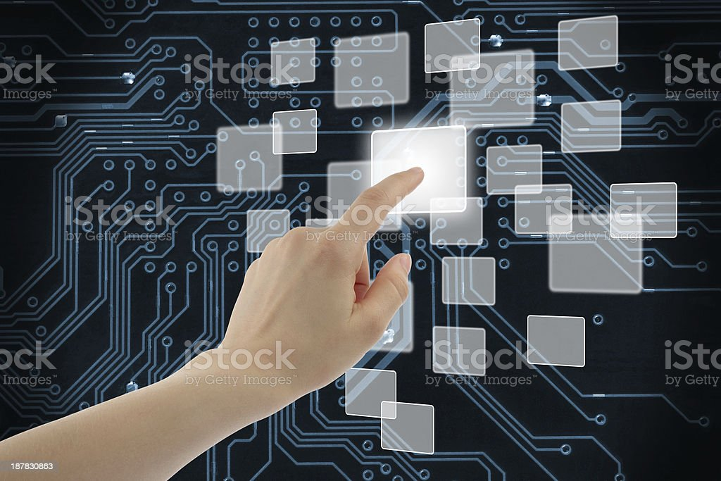 Woman hand using touch screen interface stock photo