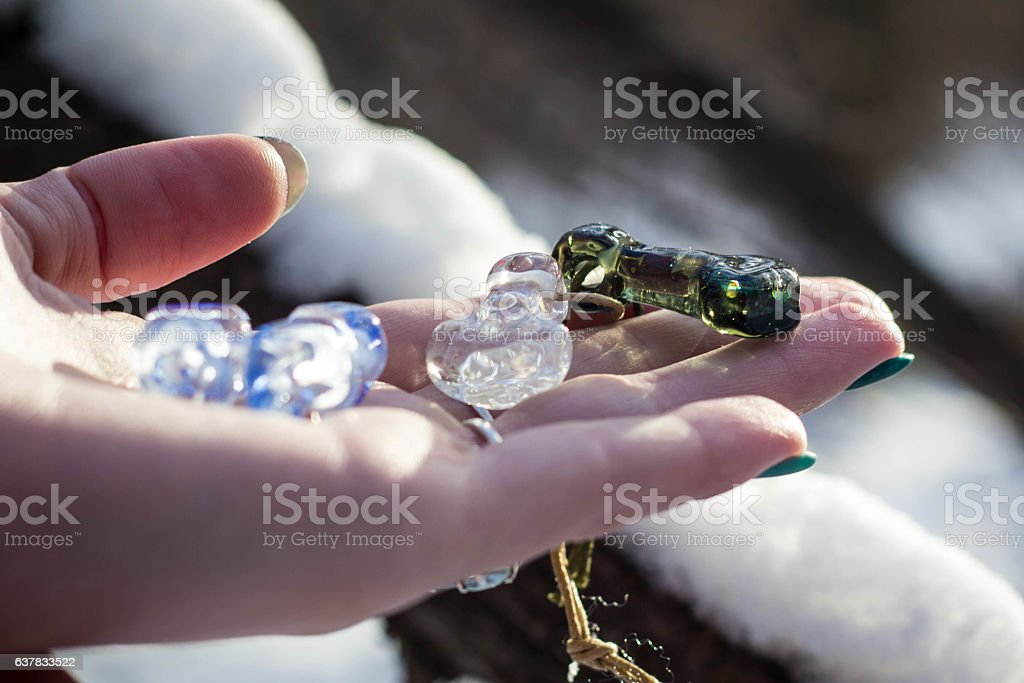 Woman hand with blue glassbeads closeup stock photo