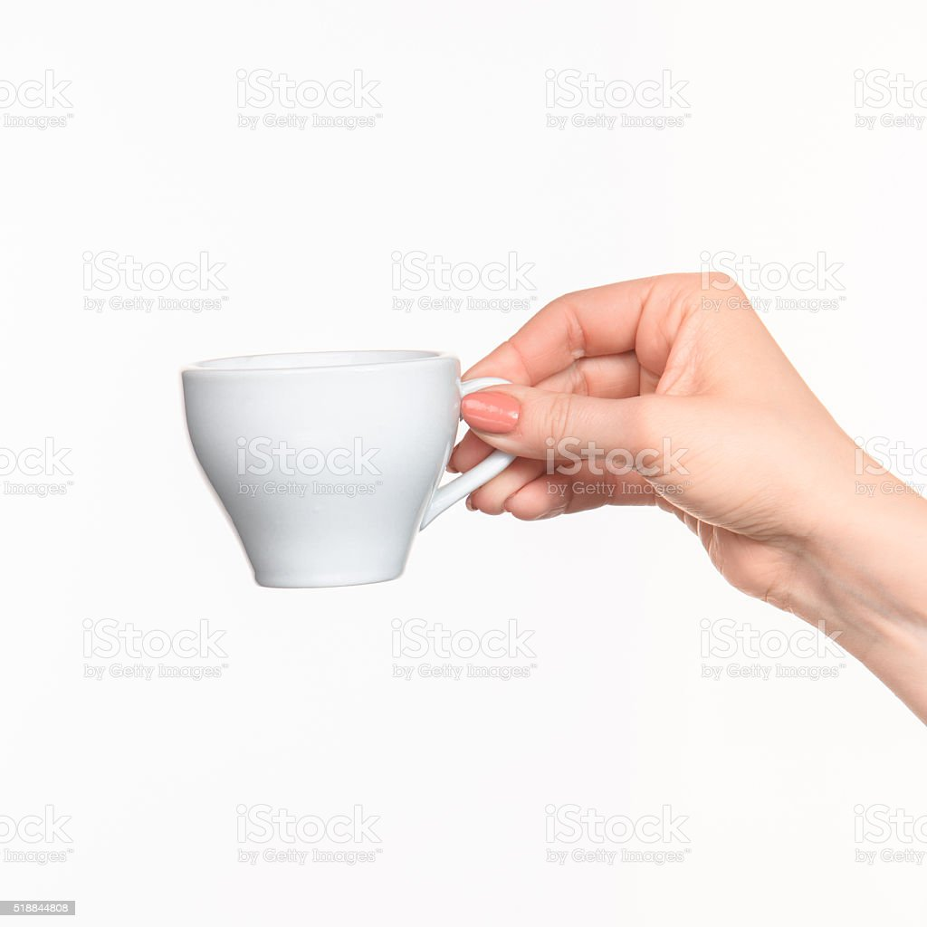 Woman hand with cup on white background stock photo