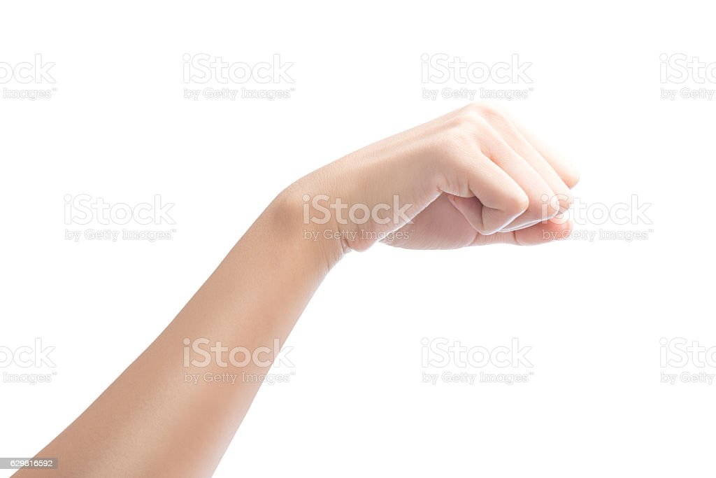 Woman hand with fist gesture Isolated. stock photo