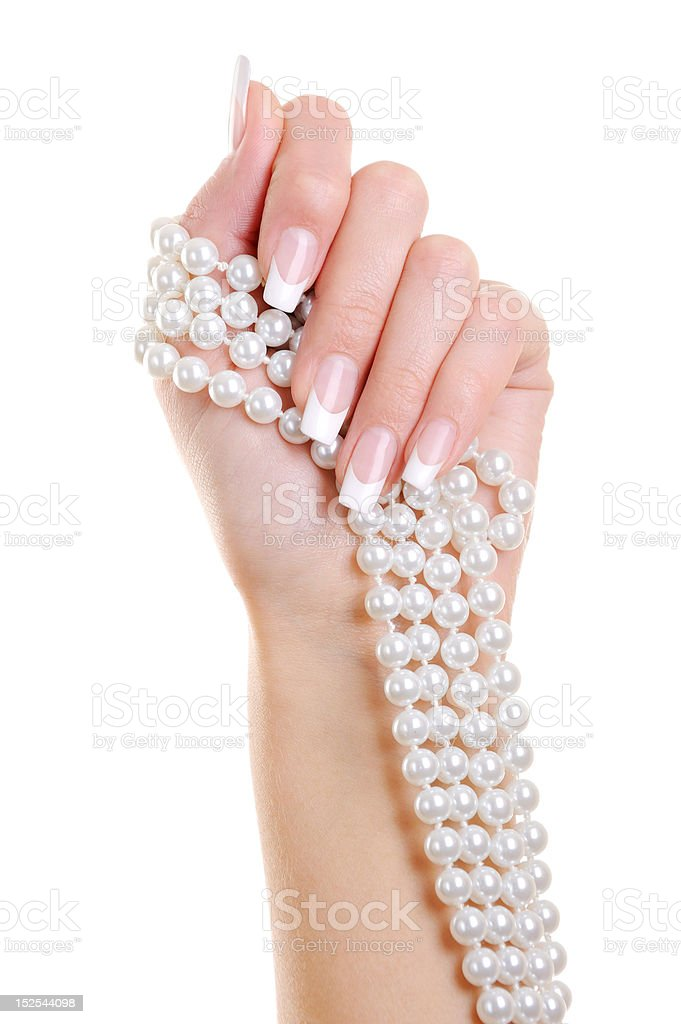 Woman hand with french manicure and  perl royalty-free stock photo