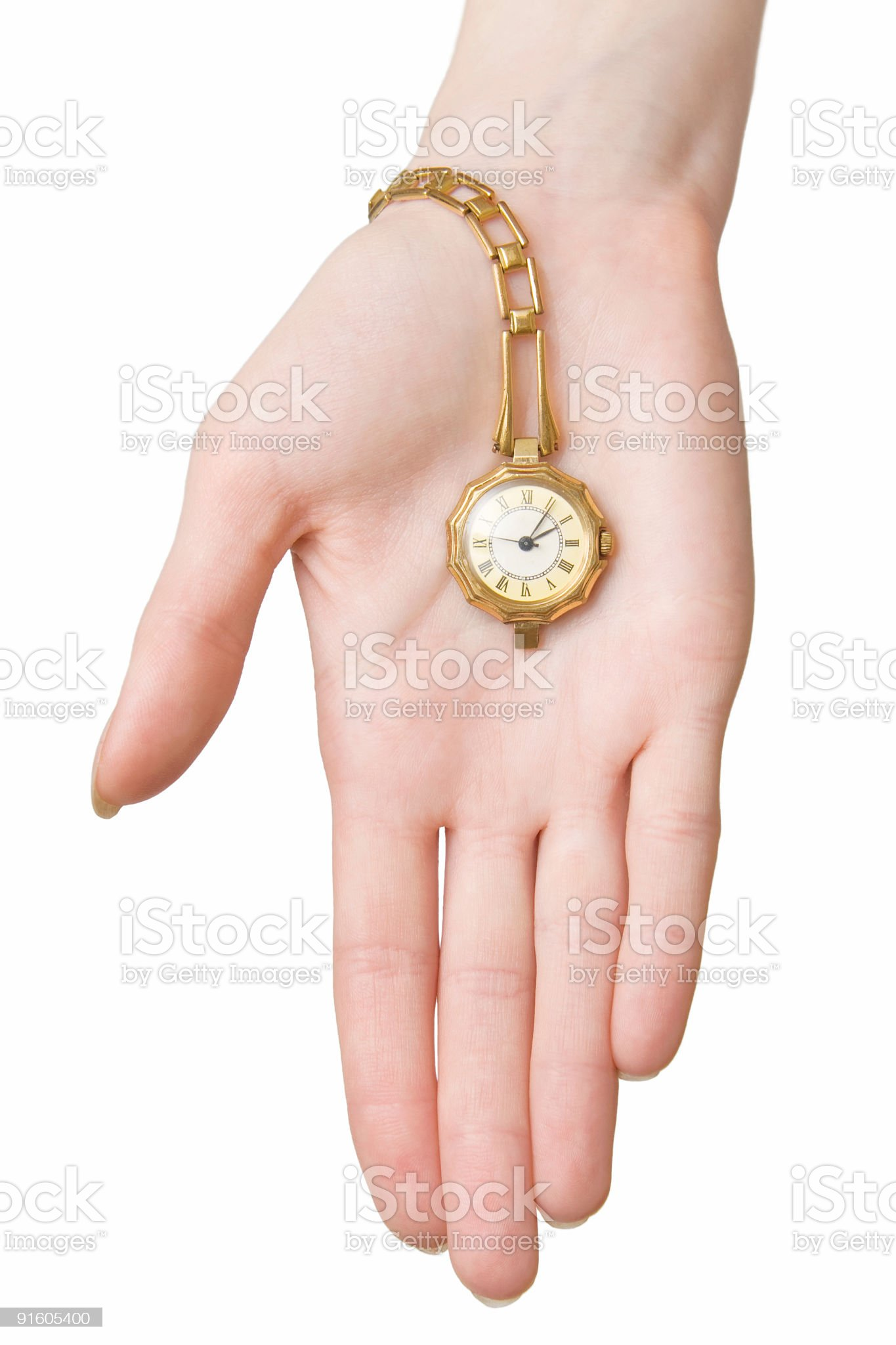 Woman hand with golden watch royalty-free stock photo