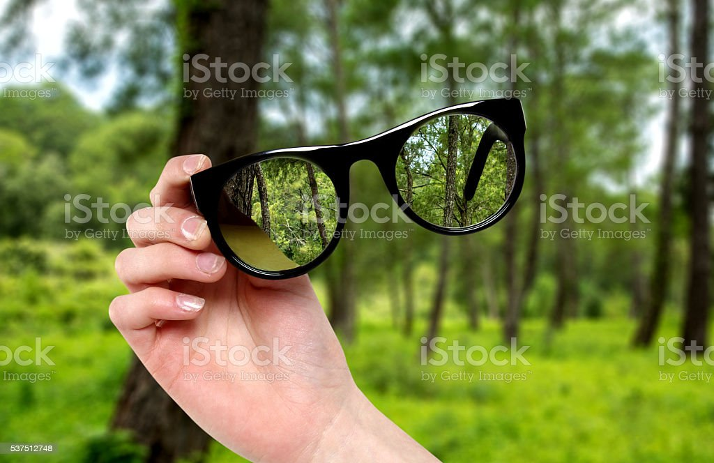 woman hand with magnifying glasses stock photo