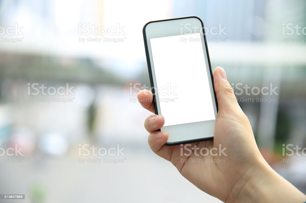 woman hand with smart phone in modern city stock photo