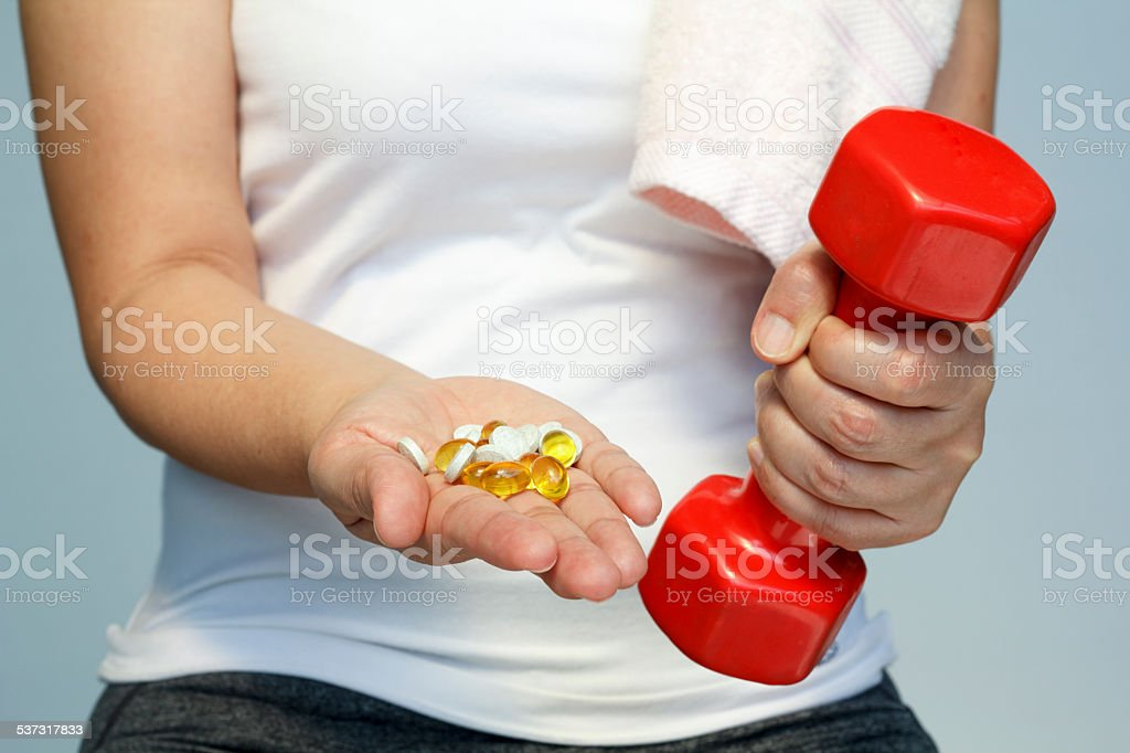 woman hand with vitamins and medication stock photo