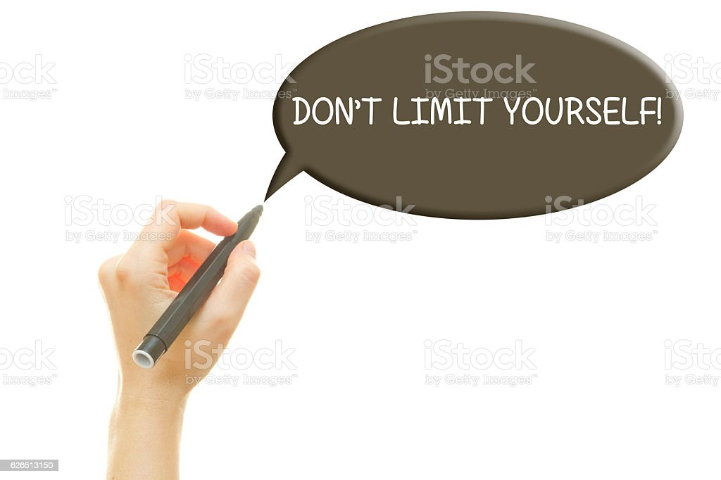 Woman hand writing DON'T LIMIT YOURSELF message stock photo