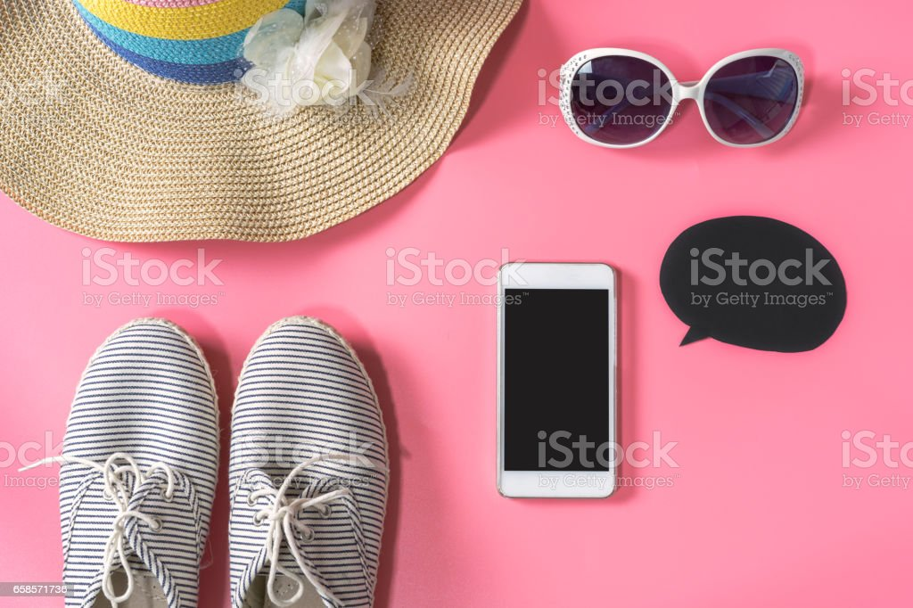 Woman handbag with makeup and accessories isolated on pink background stock photo
