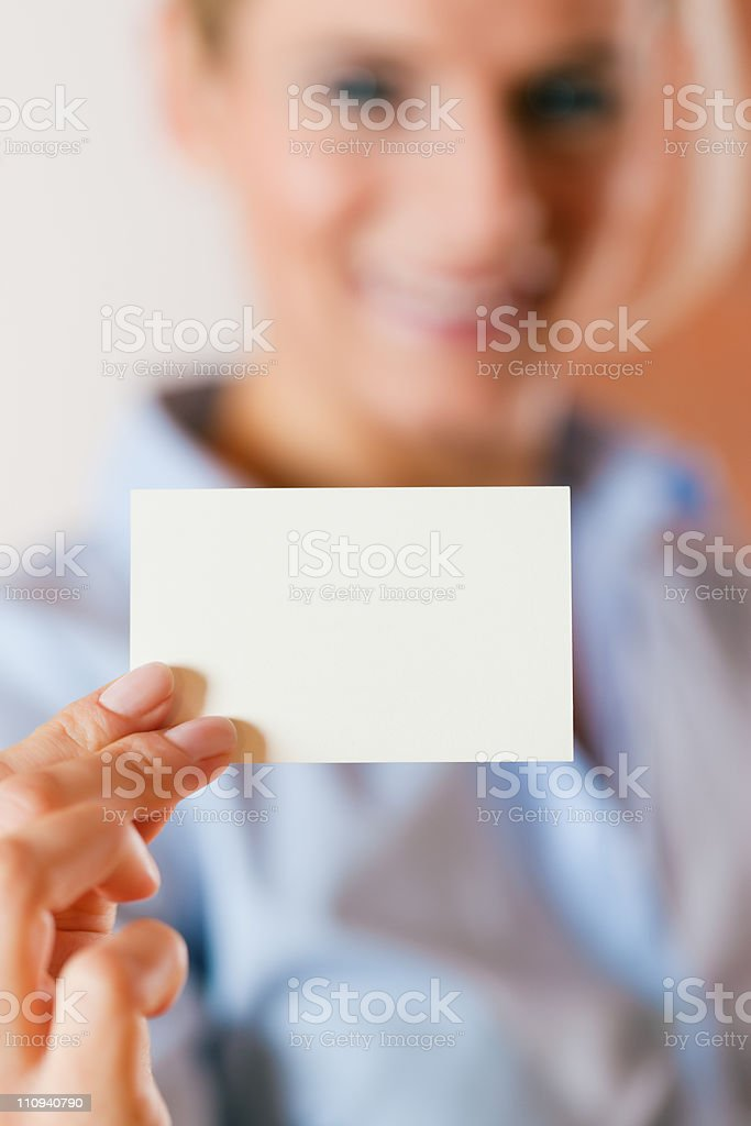woman handing over business card royalty-free stock photo