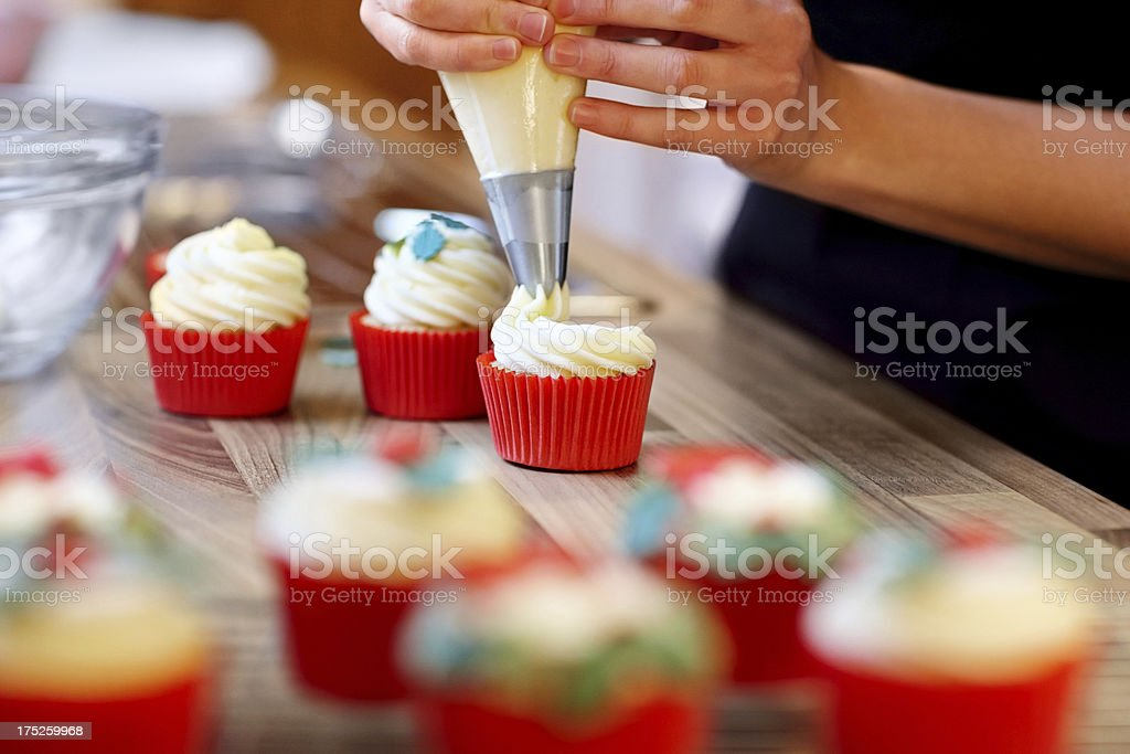 Woman hands decorating cupcakes royalty-free stock photo