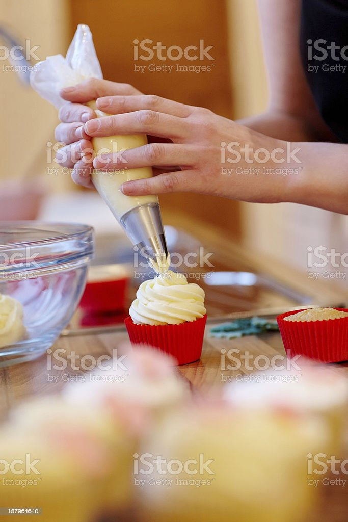 woman hands decorating cupcakes royalty free stock photo