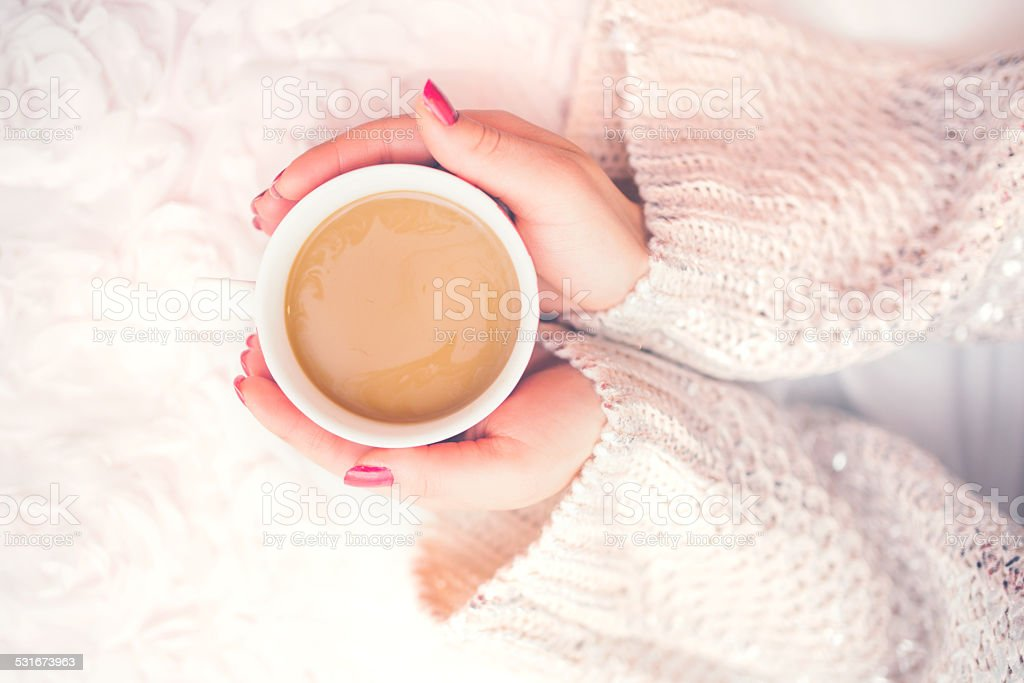 Woman hands holding a cup of hot coffee stock photo