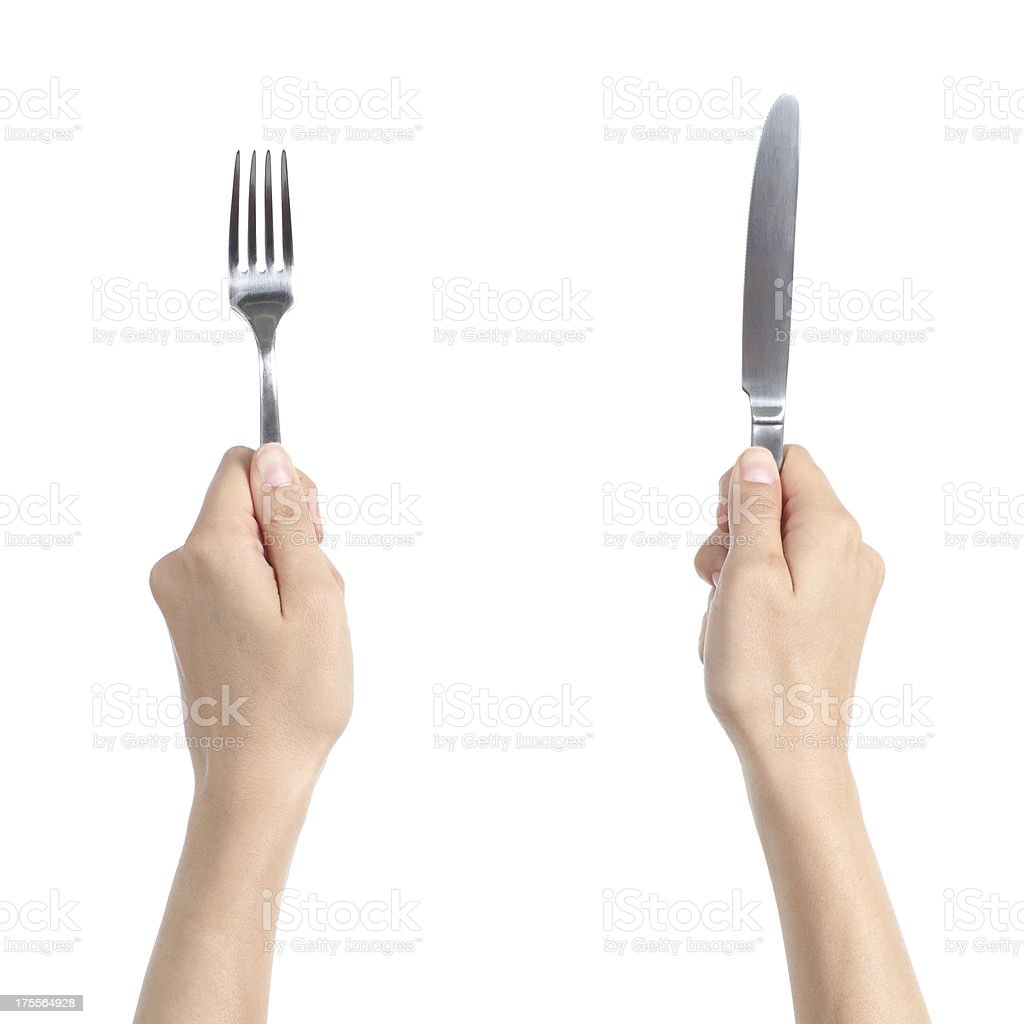 Woman hands holding a fork and knife stock photo