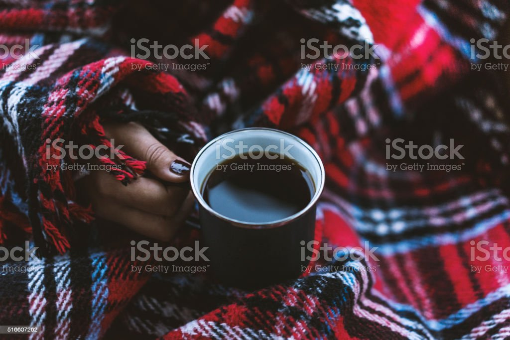 Woman hands holding coffee in a mug stock photo