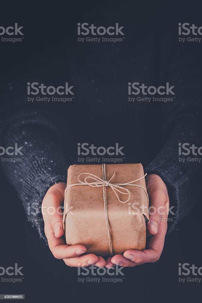 Woman hands holding gift stock photo